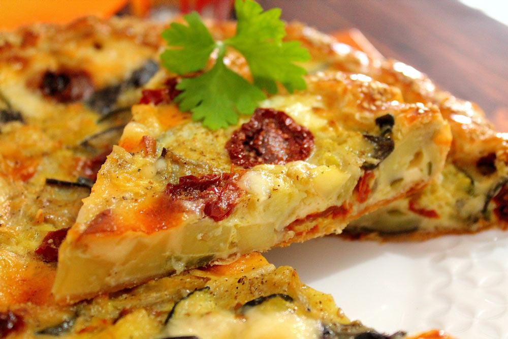Torta ortolana con pomodori secchi e provola affumicata
